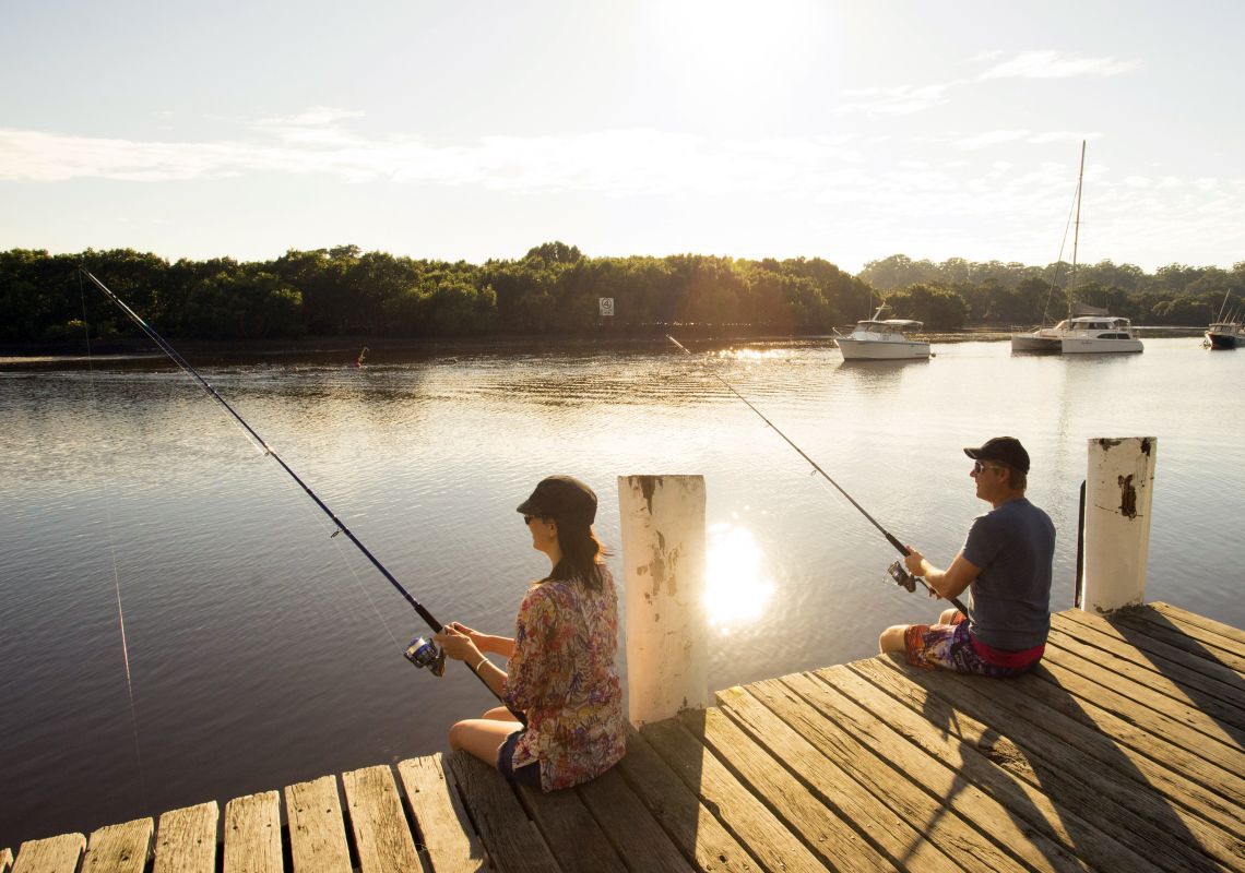 Couple fishing in Huskisson, on the shores of the spectacular Jervis Bay Marine Park in the Shoalhaven region.