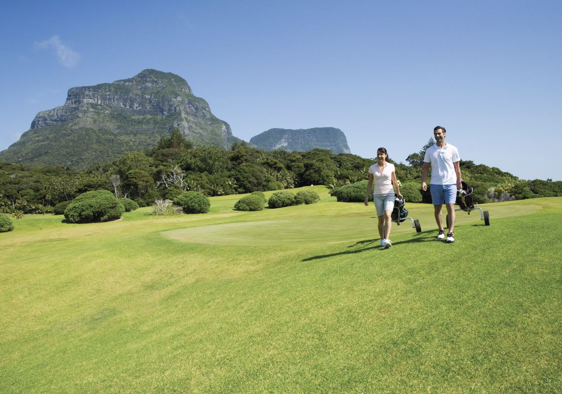 Couple enjoying a round of golf at Lord Howe Island Golf Course.