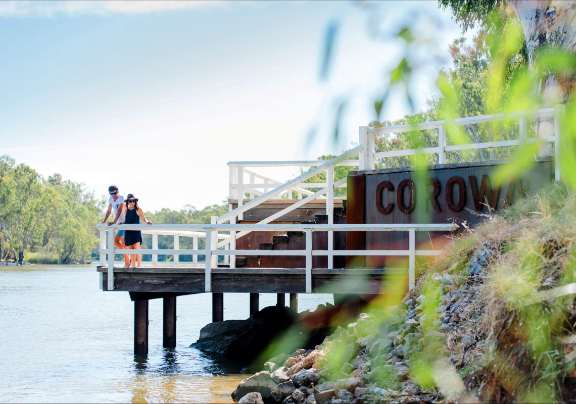 Couple on a walkway at the edge of the Murray River in Corowa, NSW