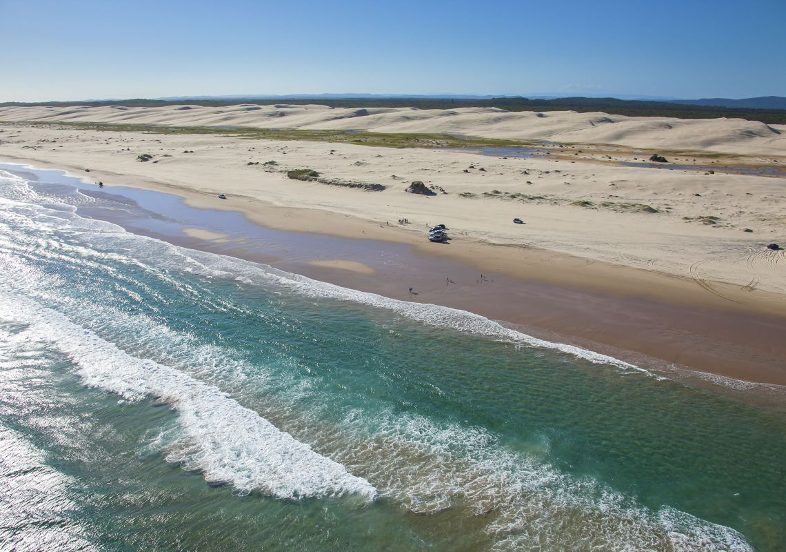 4WD vehicles on Stockton Beach in Worimi Conservation Lands, Port Stephens