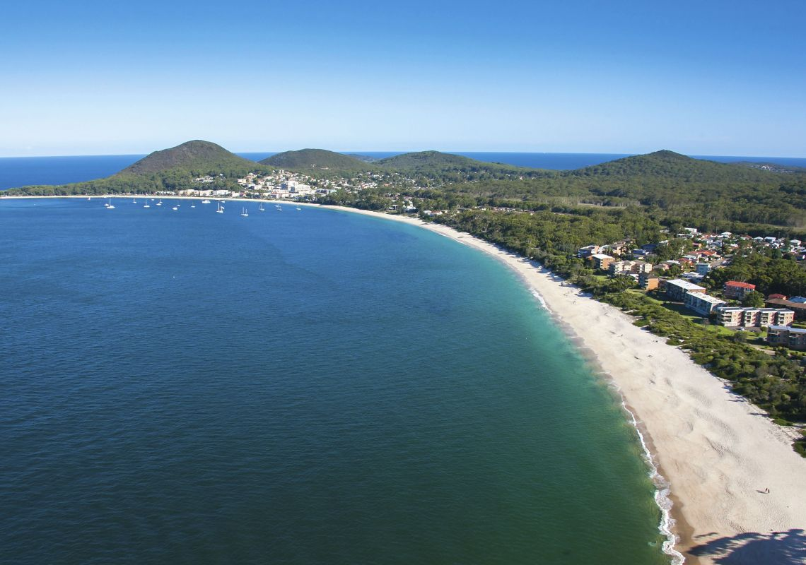Shoal Bay beach in Port Stephens, with views towards Tomaree Head
