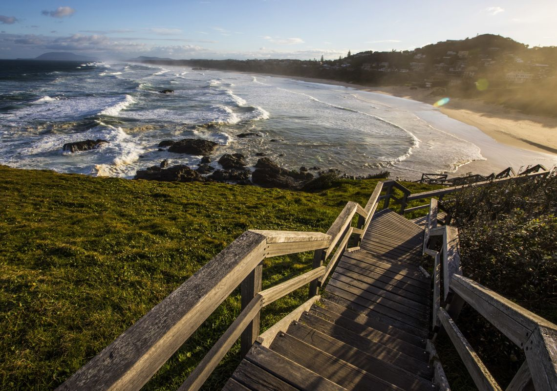 Wooden stairs descend from Tacking Point to Lighthouse Beach, Port Macquarie