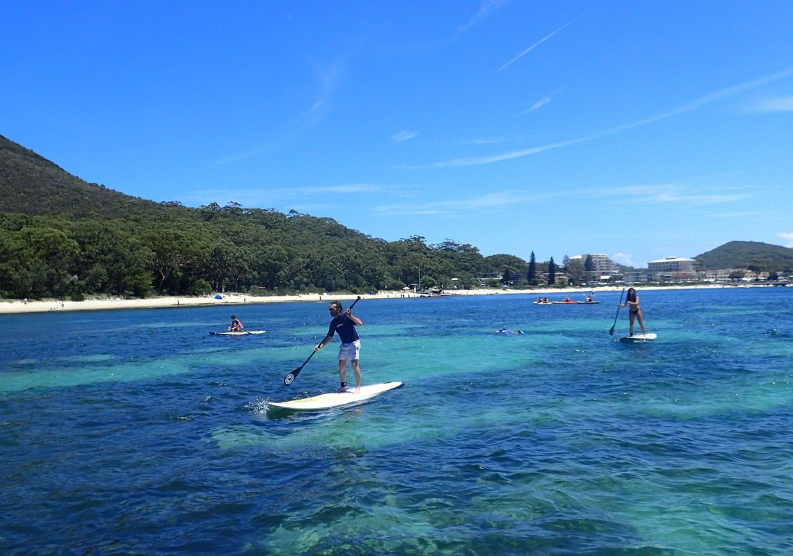 Stand-up paddleboarding in Shoal Bay, Port Stephens