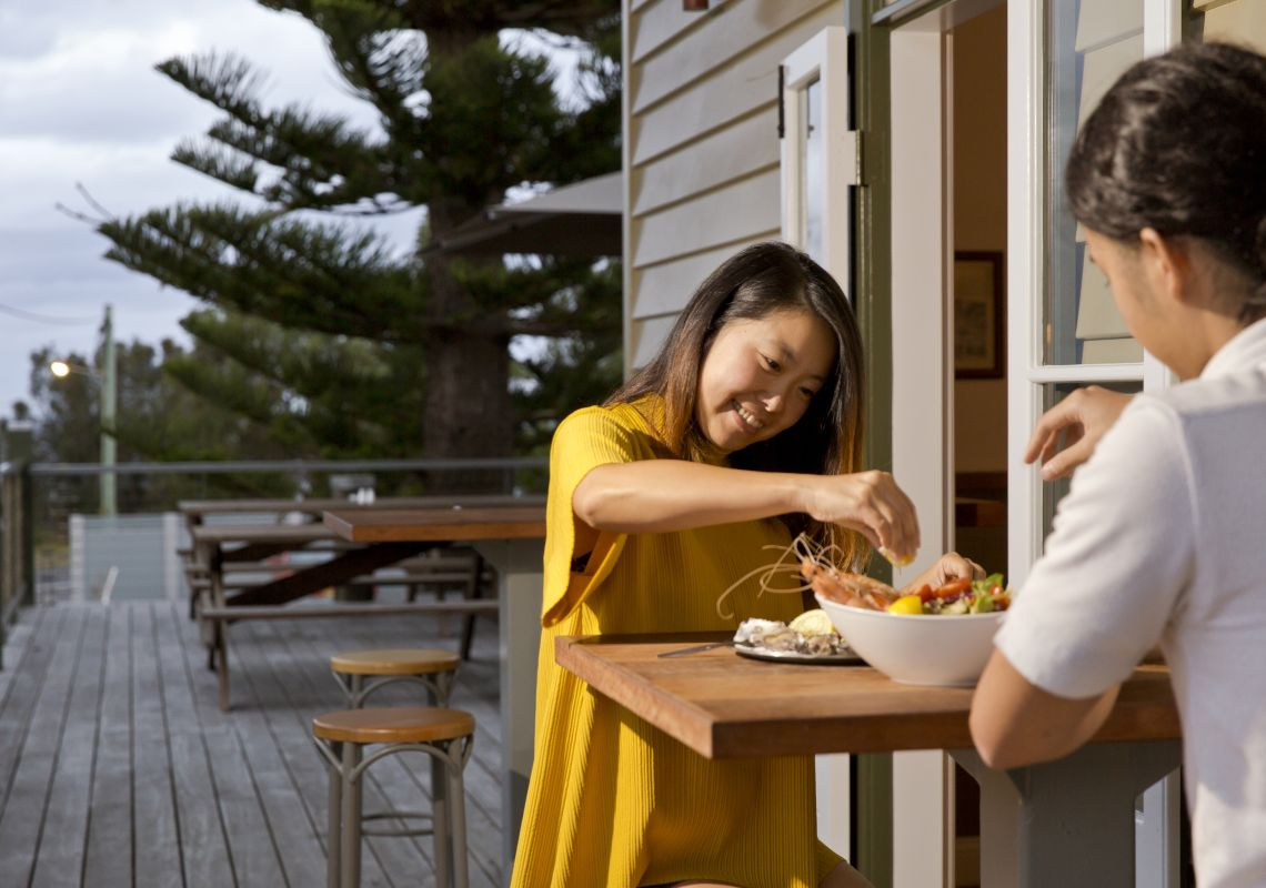 Couple enjoying a fresh seafood at the Tathra Hotel