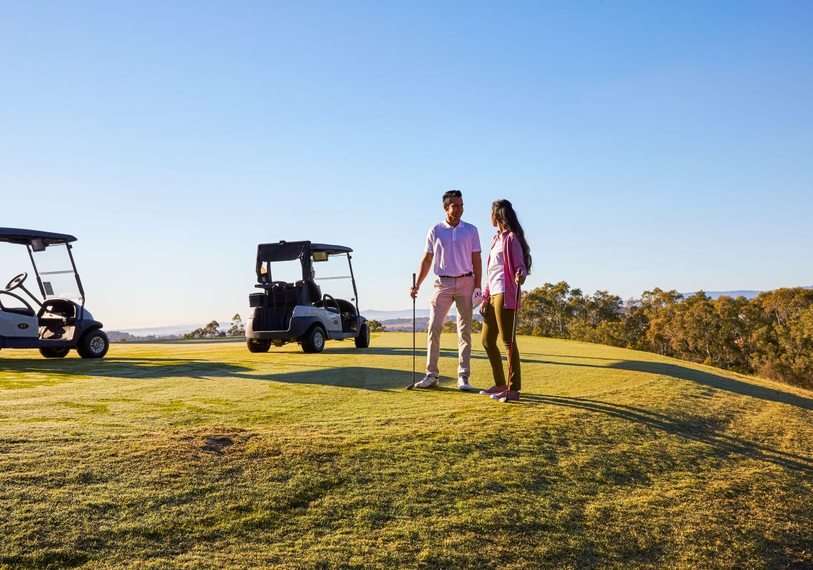 couple on the Cyprus Lakes golf course - Hunter Valley