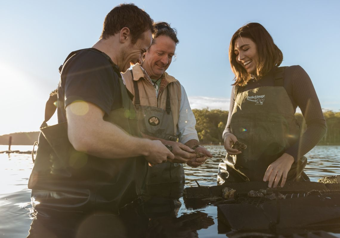 Shucking oysters on Captain Sponge's Magical Oyster Tour on the Sapphire Coast