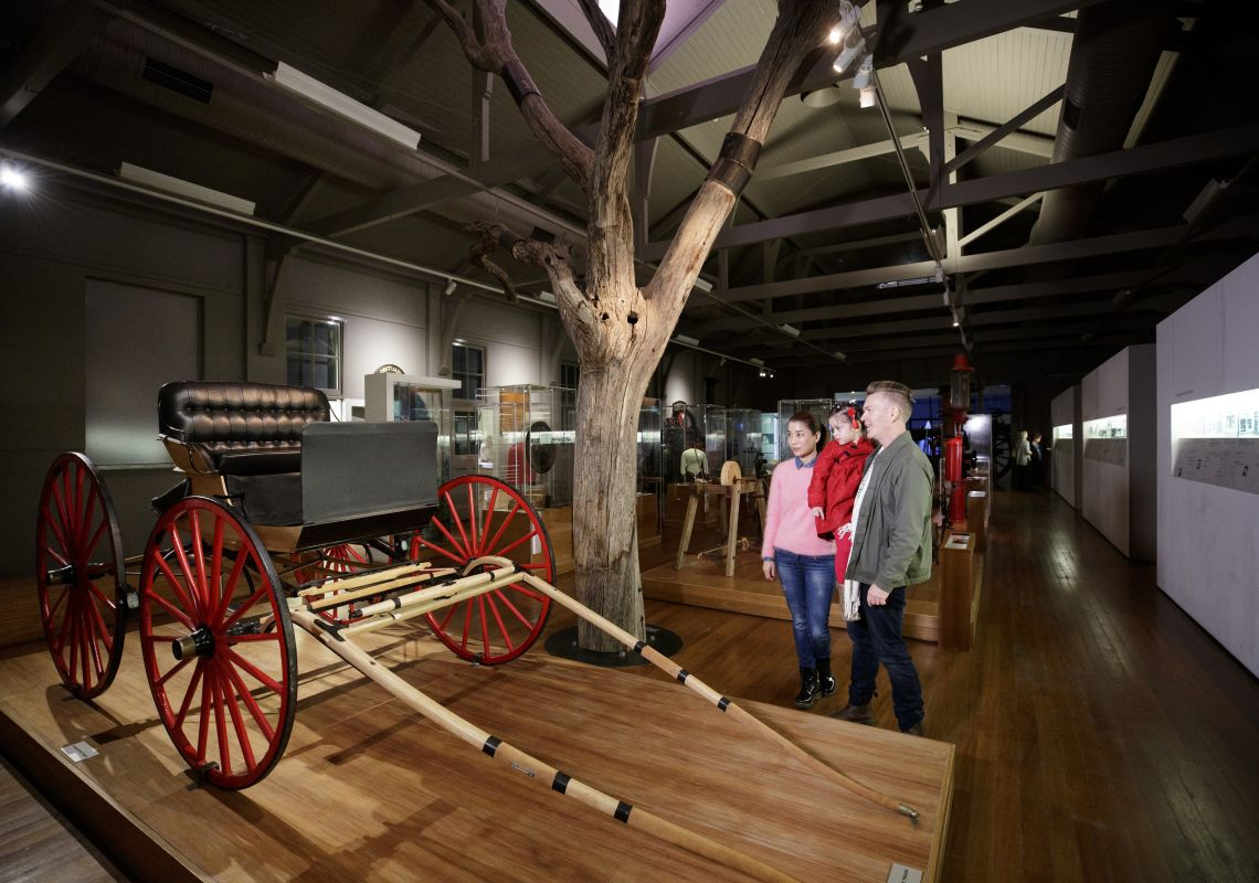 "Family enjoying the ""Peoples Places Possessions"" permanent exhibition at the Western Plains Cultural Centre in Dubbo"