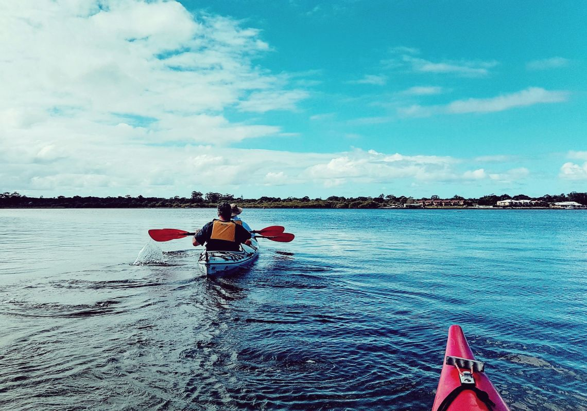 A Yamba Kayak tour paddles on the calm Clarence River estuary, NSW North Coast