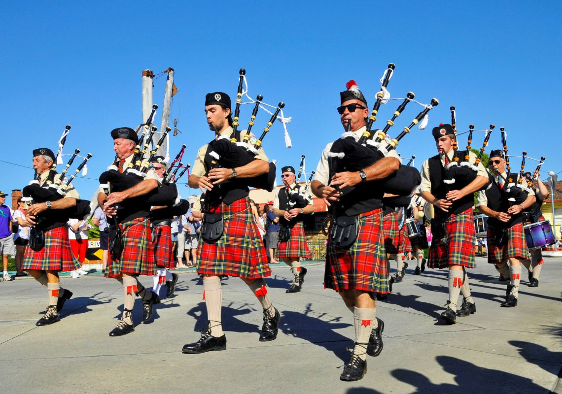 Bagpipers in kilts parade at the Highland Gathering festival in Maclean, Clarence Valley