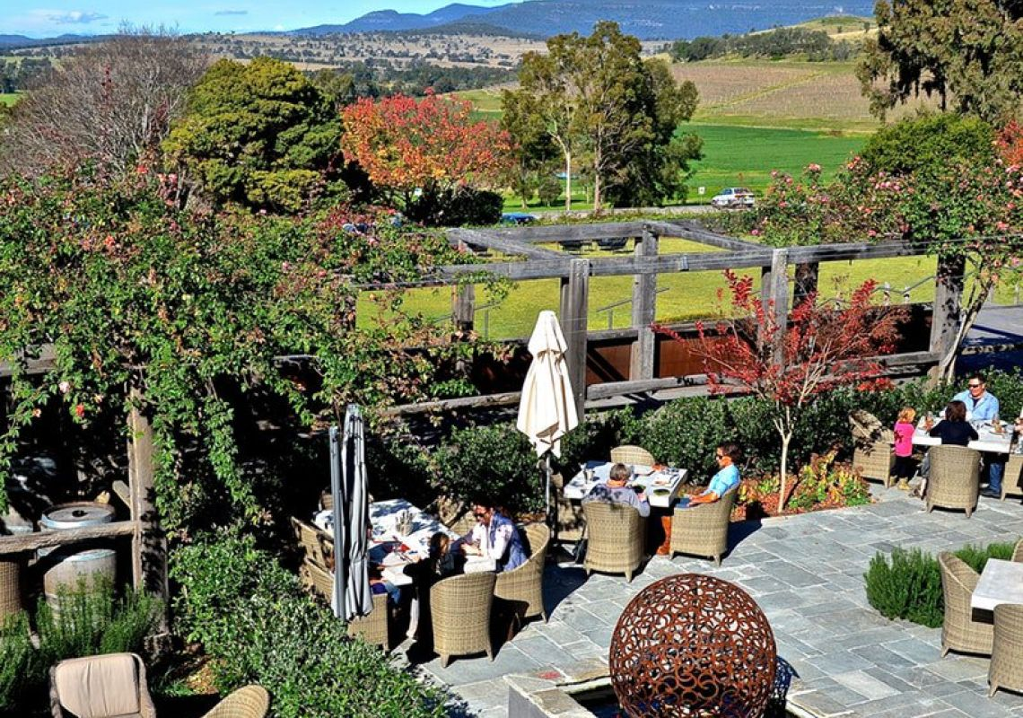 Diners enjoying outdoor dining with scenic vineyard views at Vines Restaurant in Hollydene Estate, Upper Hunter