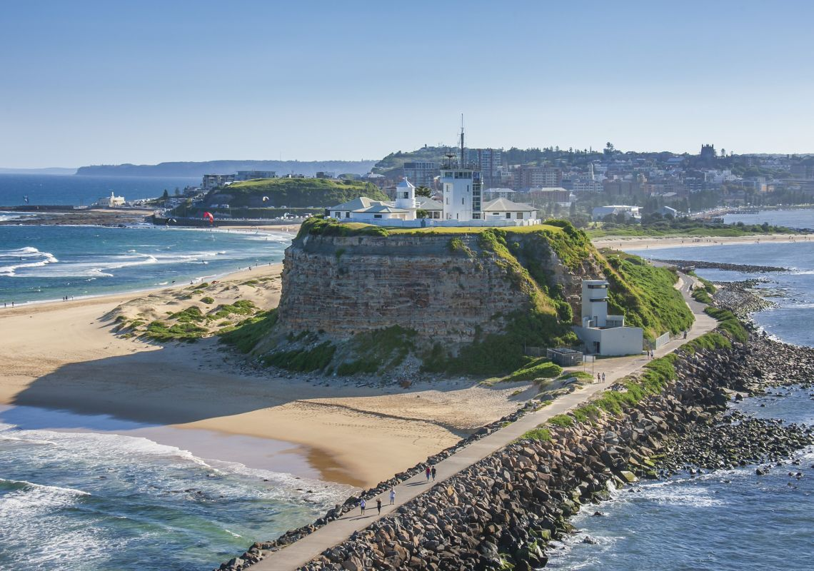 Coastal aerial of Fort Scratchley Historic Site and Nobbys Beach in Newcastle