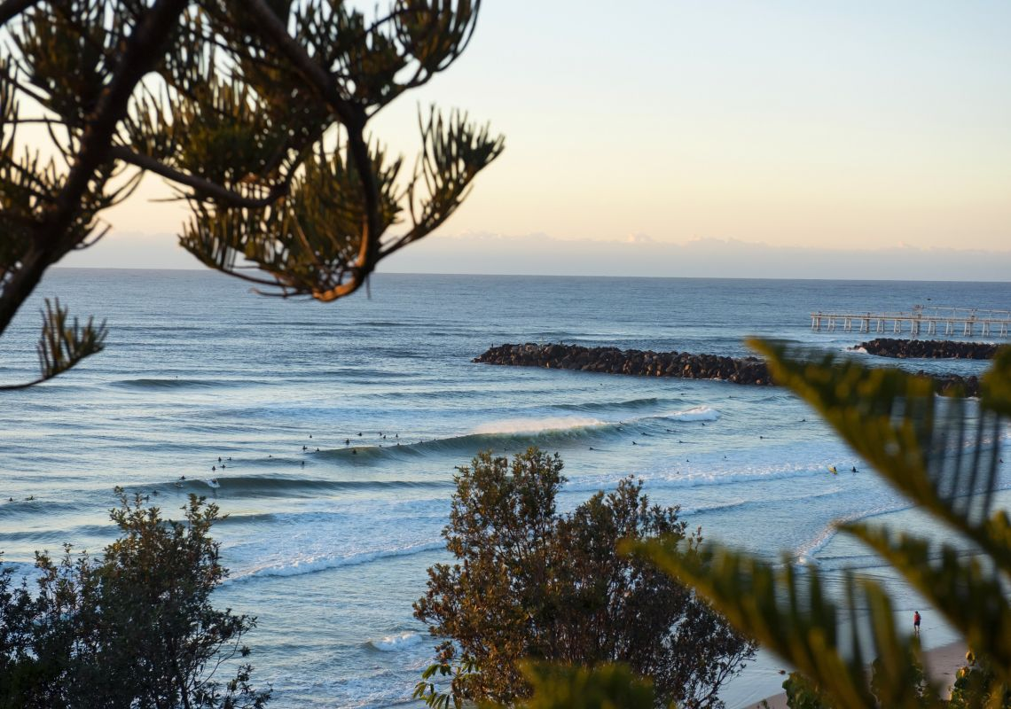 Surfers catching a morning wave at Duranbah Beach, Tweed Heads