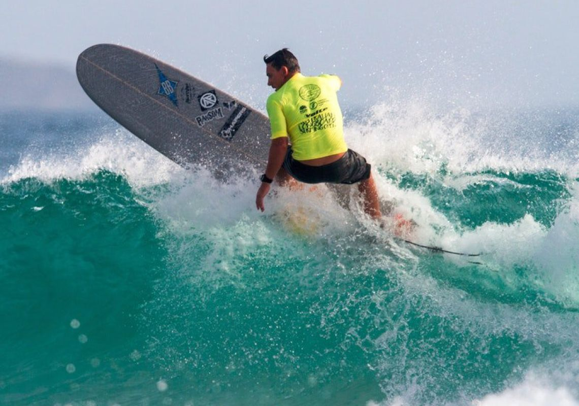 Surfer carves up a wave at the Australian Longboard Surfing Open in Kingscliff.