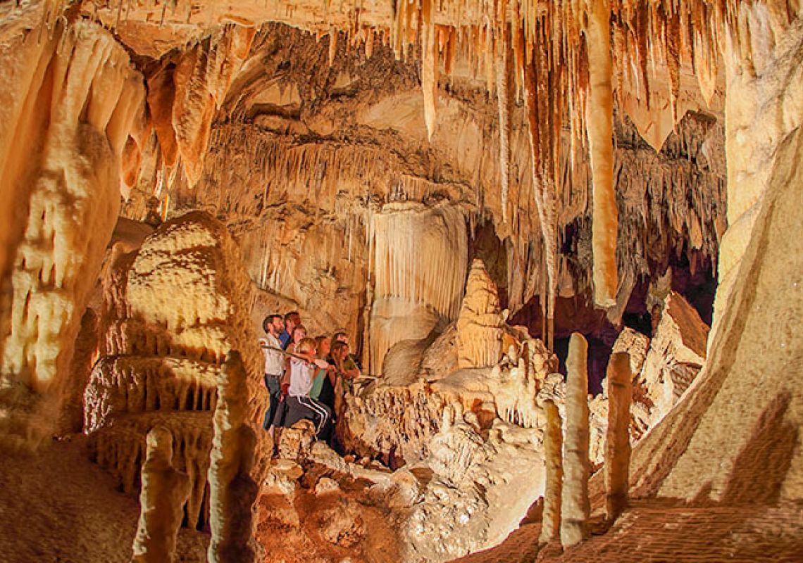 A group exploring inside Kooringa Cave, in the Wombeyan Caves