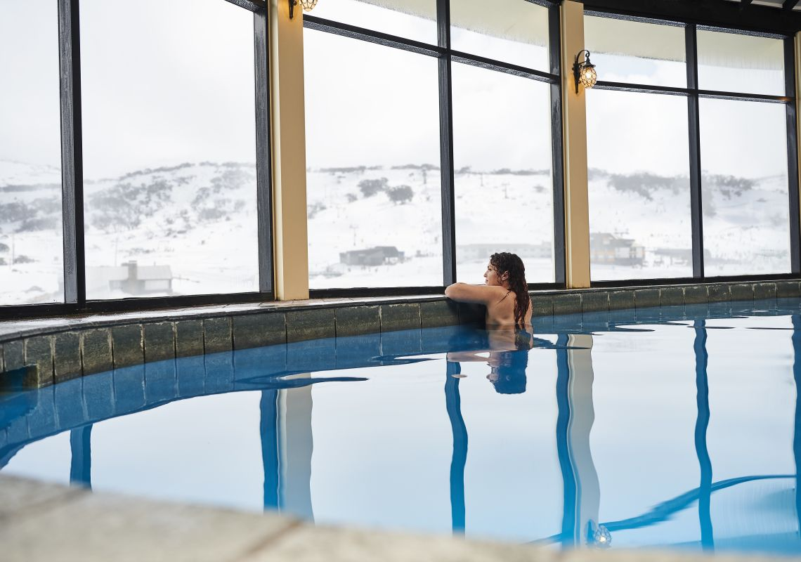 A woman enjoying a swim at Perisher's only heated pool in the Marritz Hotel