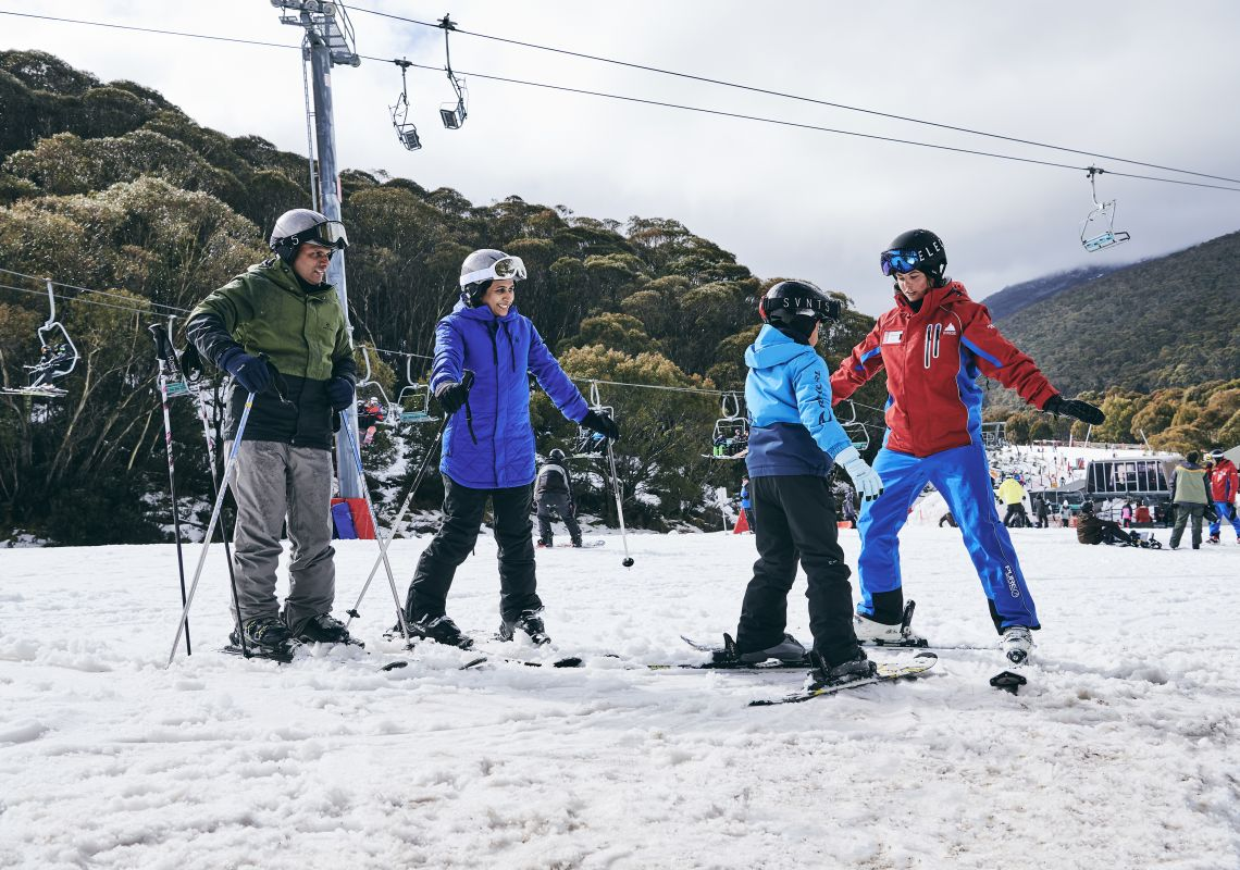 Family learning how to ski with the instructor at Thredbo in the Snowy Mountains