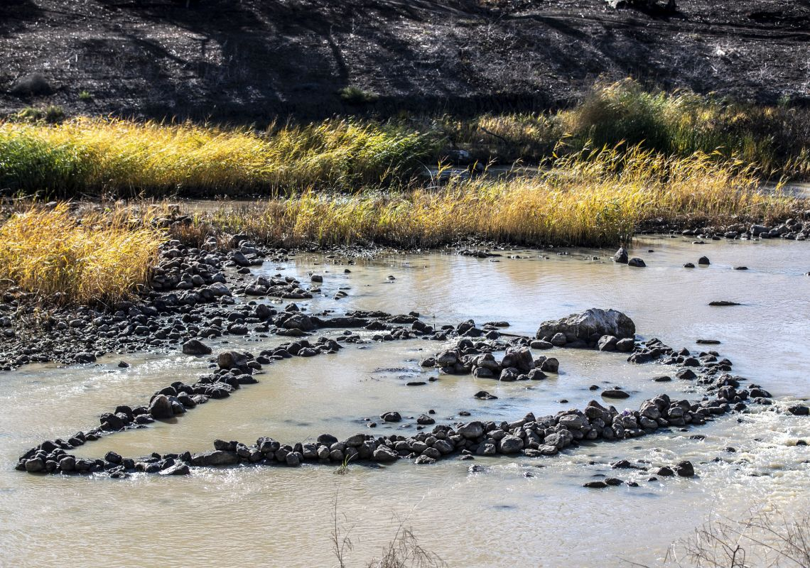 Stones in the Barwon River that form the ancient Aboriginal Brewarrina Fish Traps
