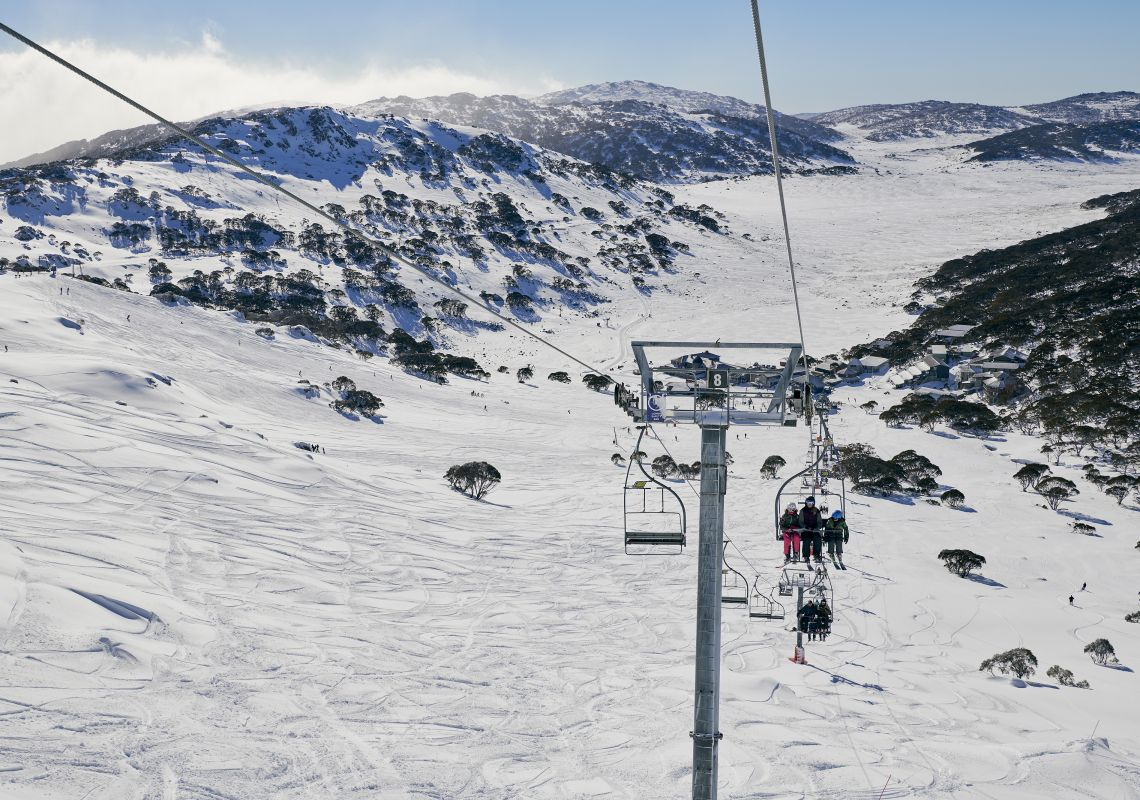Skiiers riding the chair lifts at Charlotte Pass Ski Resort in the Snowy Mountains