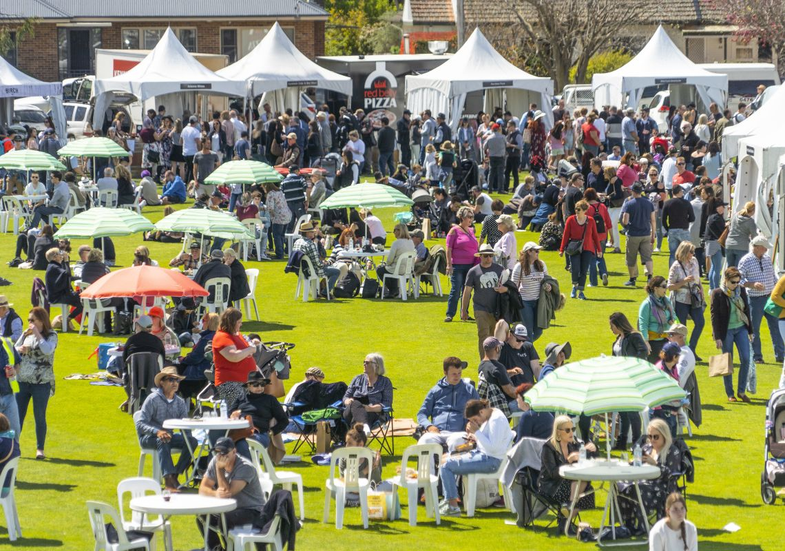 People enjoying the sun and festivities at the Southern Highlands Food and Wine Festival at the iconic Bradman Oval in Bowral