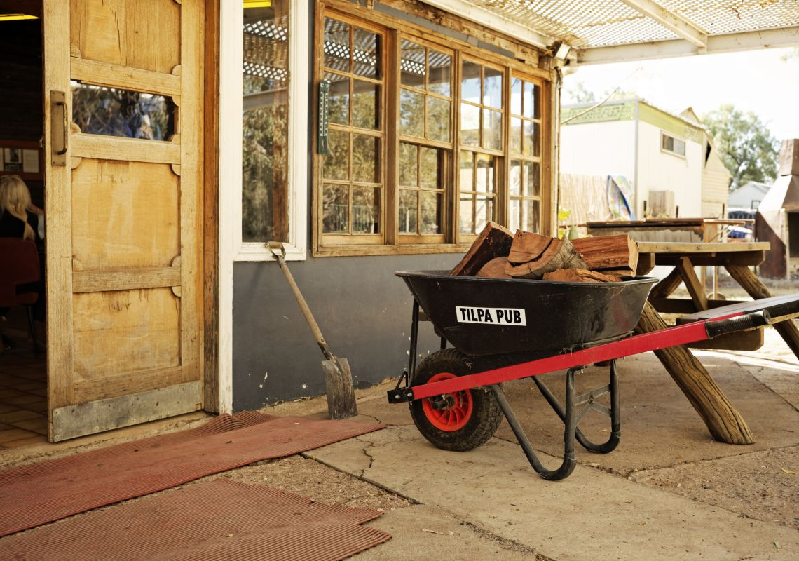 A wheelbarrow outside the historic Tilpa Hotel