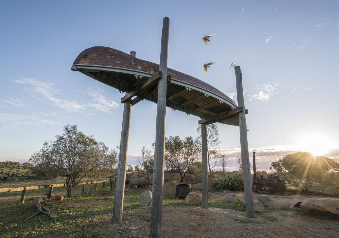 The Myth and Mirage sculpture is a replica of Charles Sturt's whaleboat is suspended upside down high in the air in Pioneer Park, Tibooburra