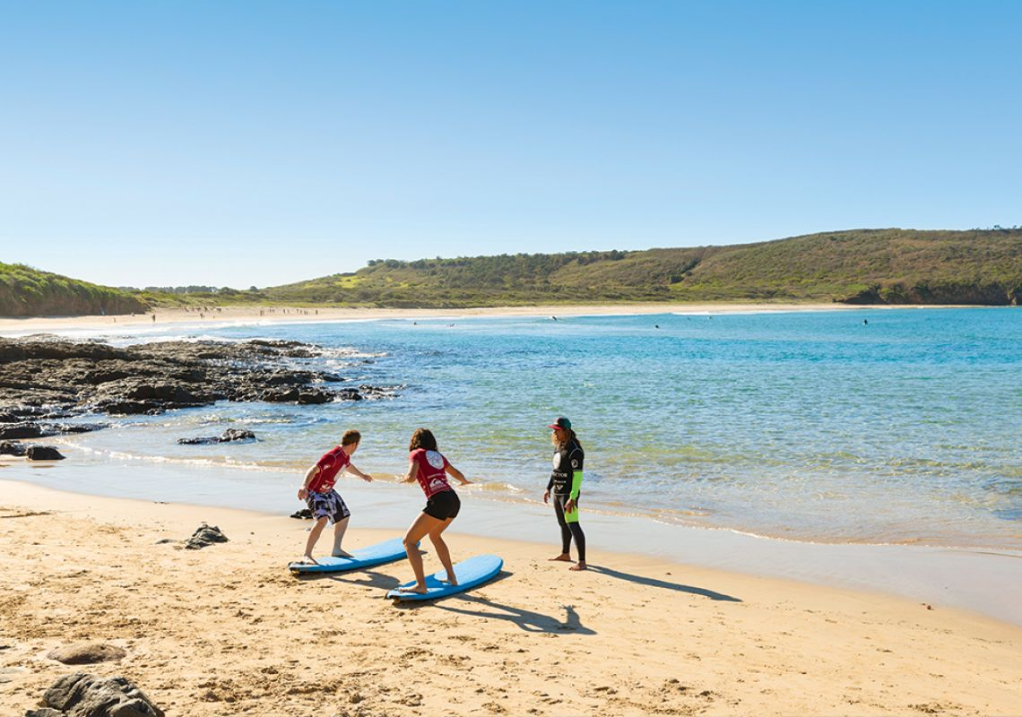 Surf lessons at The Farm in Killalea State Park - South Coast