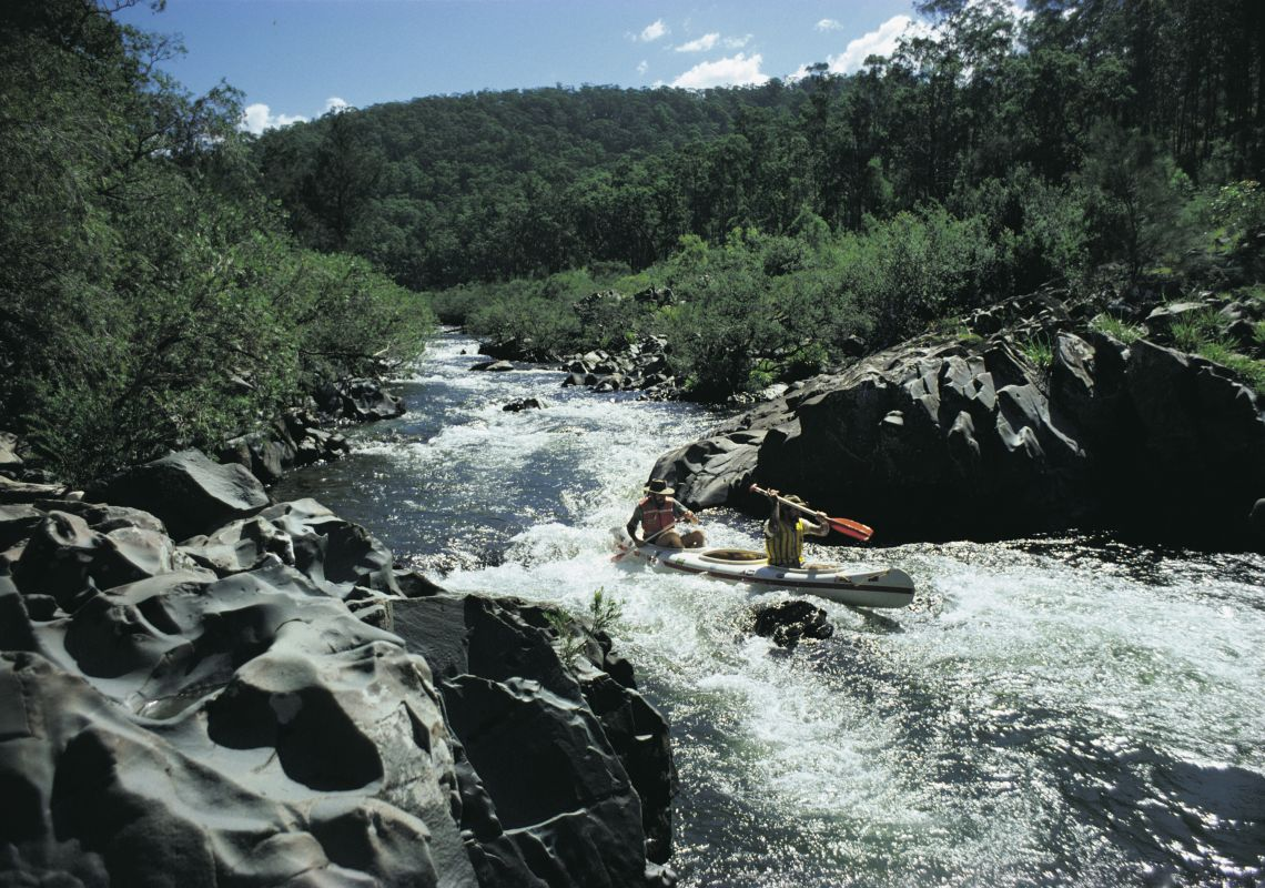 Two people kayaking down rapids in Barrington Tops National Park, Hunter