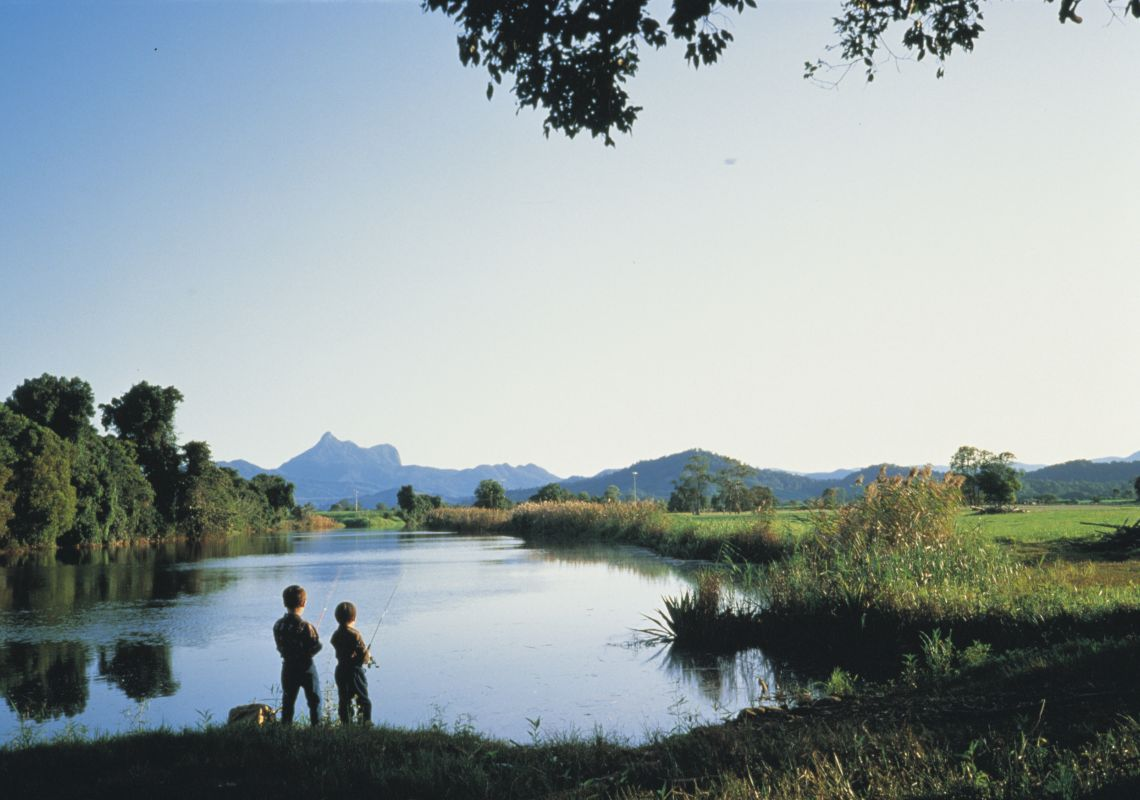 Boys fishing on the Tweed River at Mt Warning NP