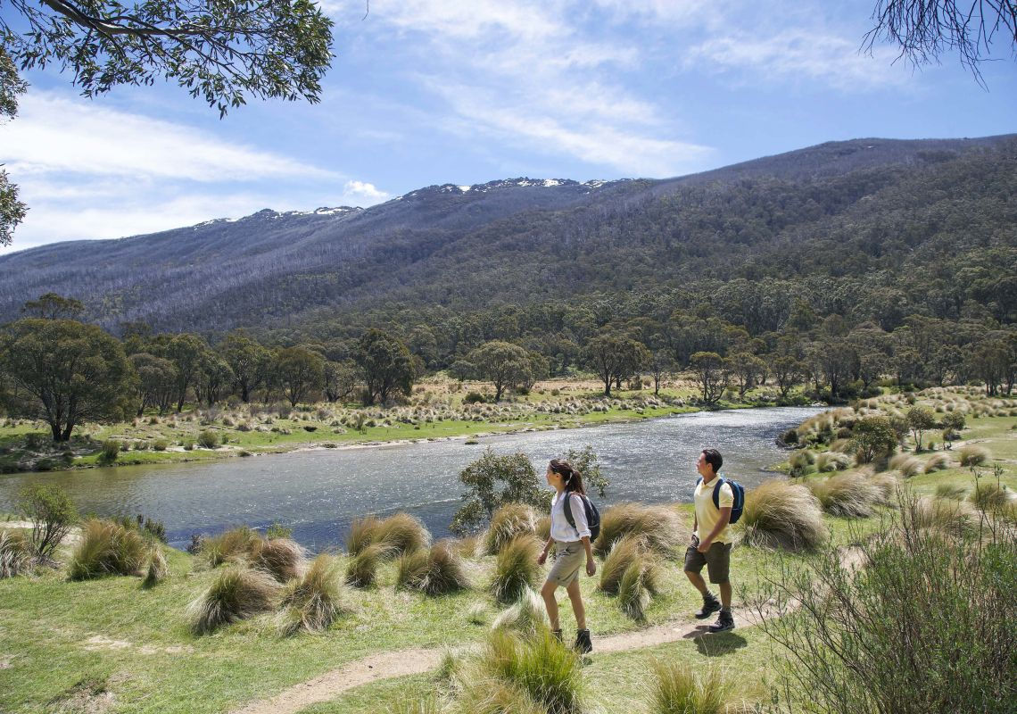 Couple enjoying a scenic bushwalk by Thredbo River near The Diggings Campground in Kosciuszko National Park
