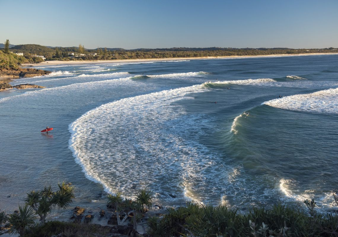 Surfers catching a morning wave at Cabarita Beach