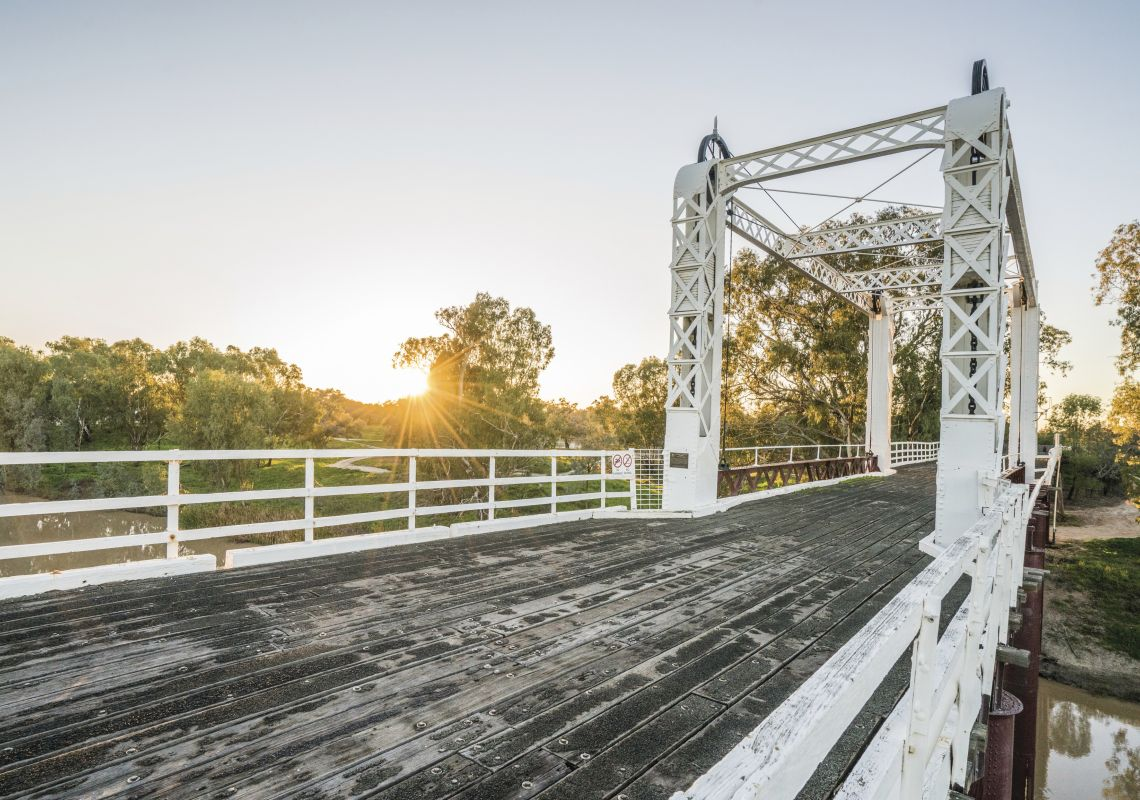 A white wooden bridge crosses the Darling River, Bourke
