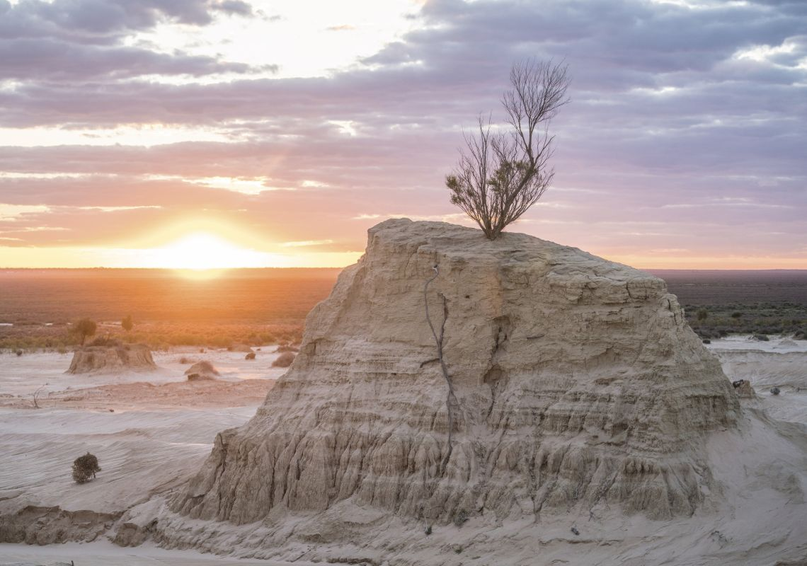 The sun sets over the striking rock formations of the Walls of China, Mungo National Park