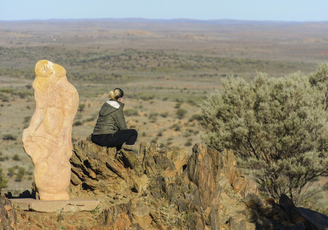 A woman looks out over the plains from the Living Desert and Sculptures, Broken Hill