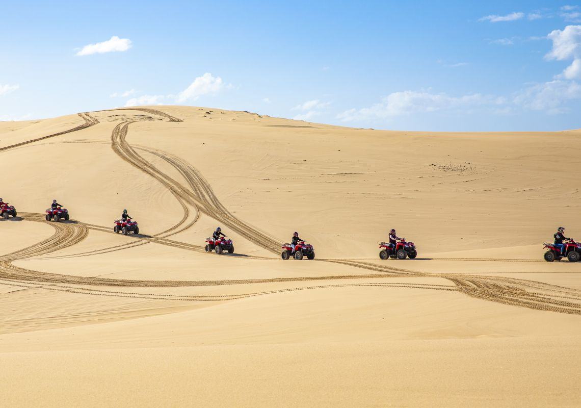 Small group enjoying an Aboriginal cultural tour on quad bikes with Sand Dune Adventures, Port Stephens