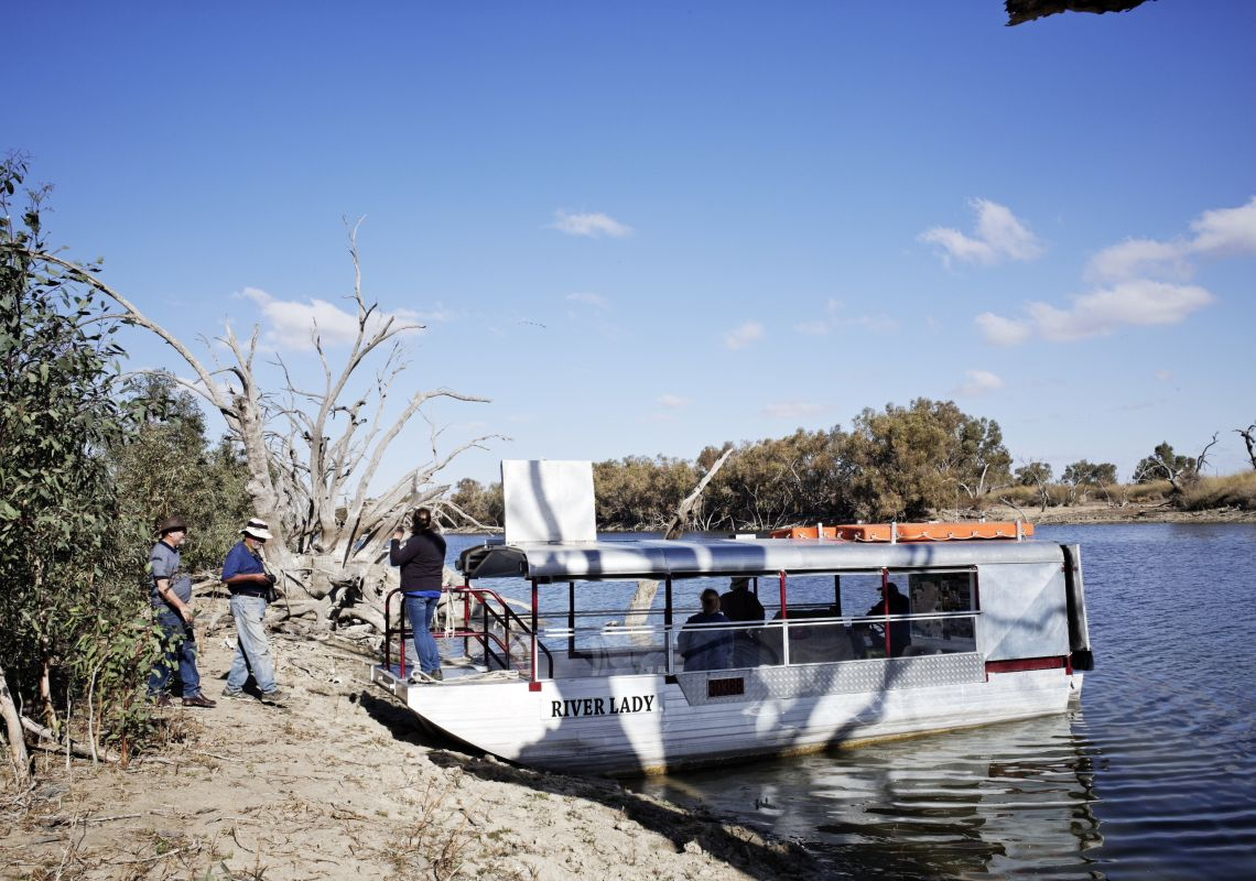 A tour group boards the River Lady cruise boat on the Menindee Lakes