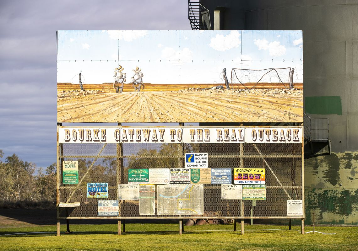 A sign reading 'Bourke: Gateway to the real Outback' on the streets of Bourke