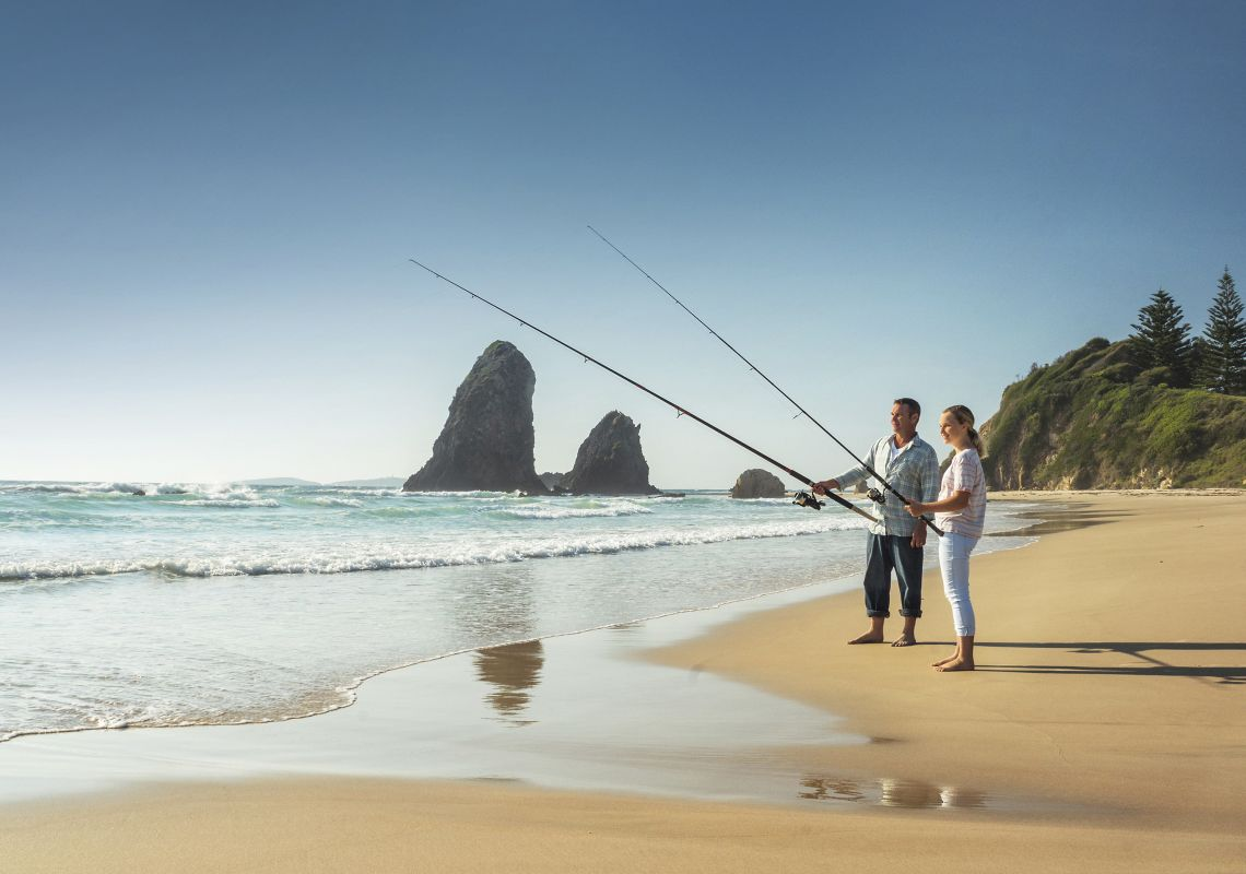 Father ad daughter enjoying a morning of fishing at Glasshouse Rocks, Narooma