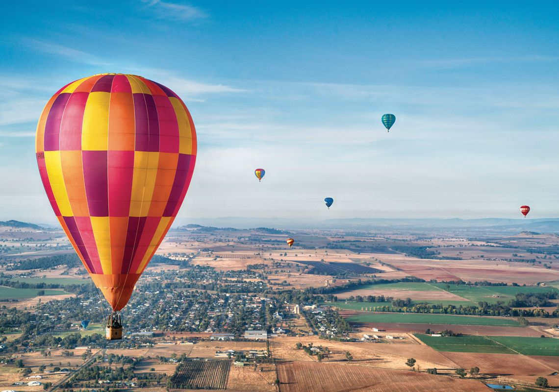 Hot air balloons flying over central NSW during the Canowindra International Balloon Challenge