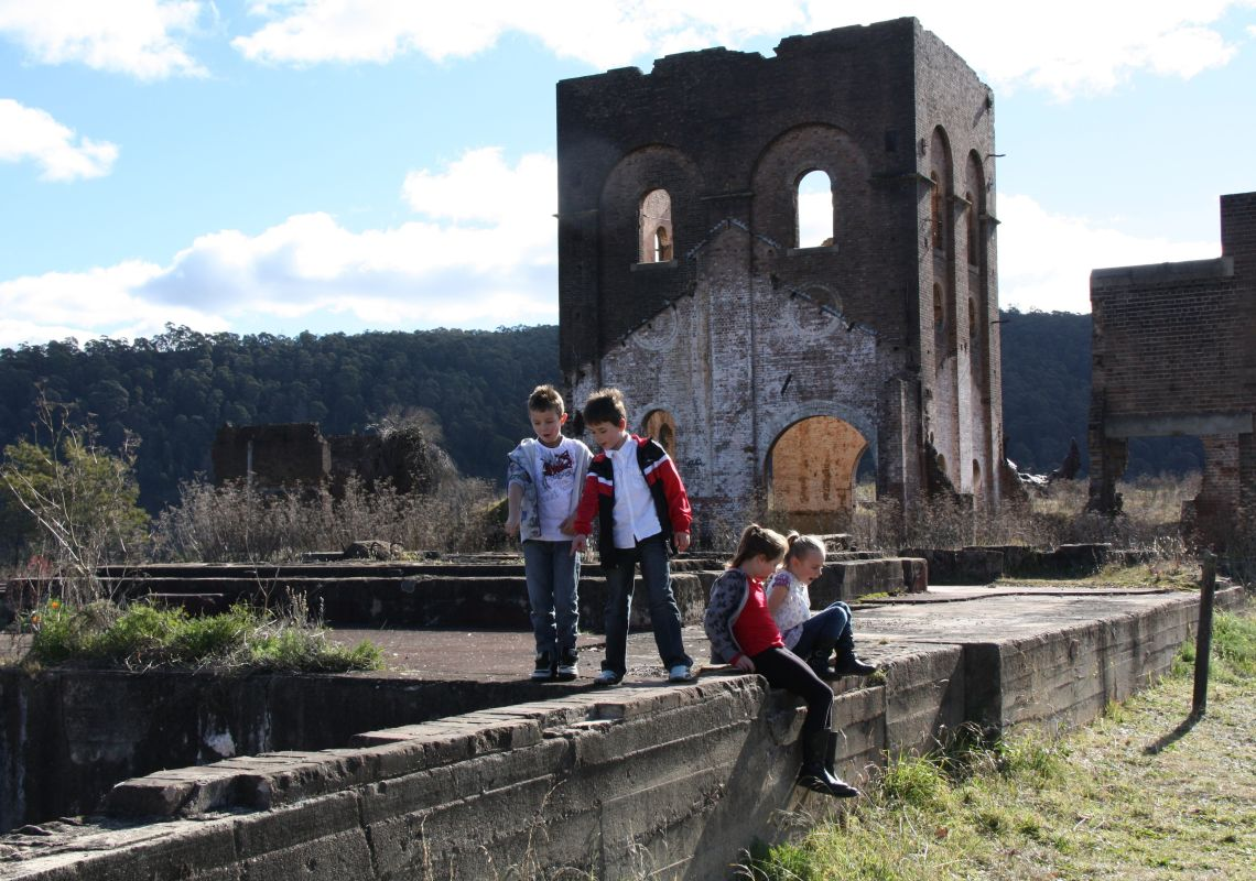 Children exploring the Blast Furnace Park, the remains of a pump house and furnace, Lithgow