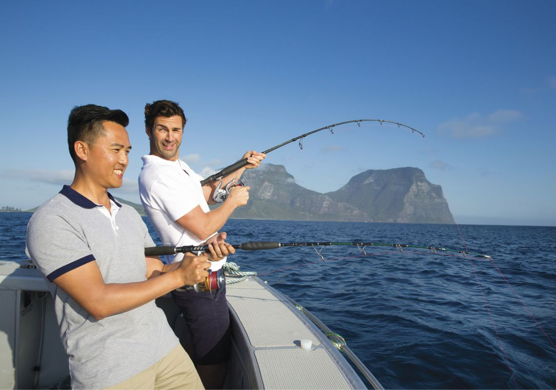 Friends enjoying a day out in the ocean deep sea fishing off Lord Howe Island