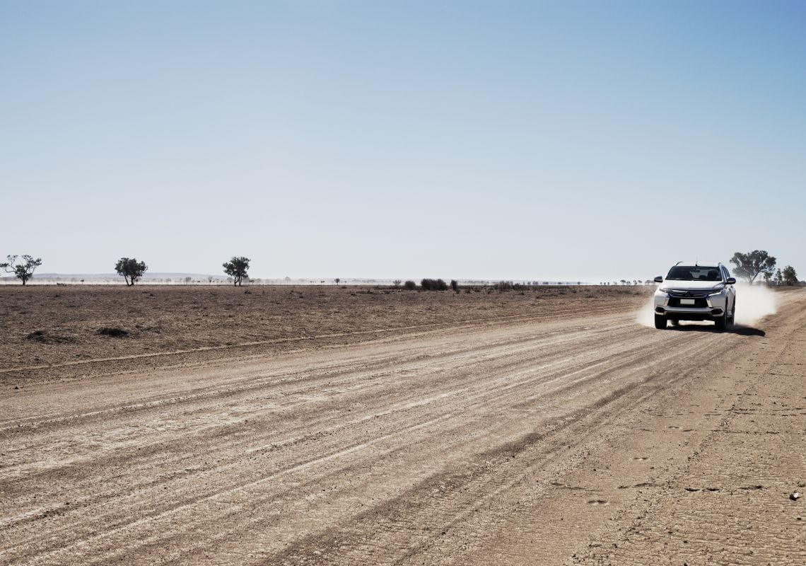4WD driving on a country road near Tilpa in Central Darling NSW