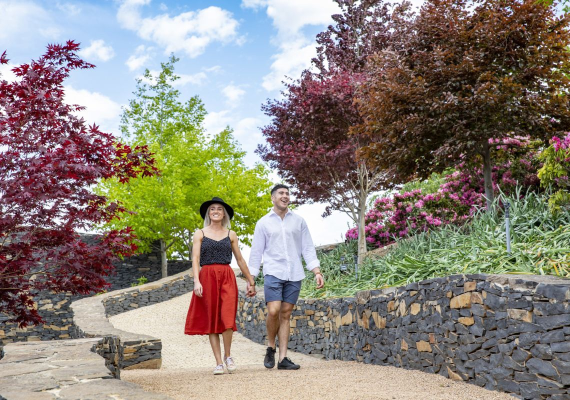 Couple enjoying the spring blooms at Mayfield Garden, Oberon