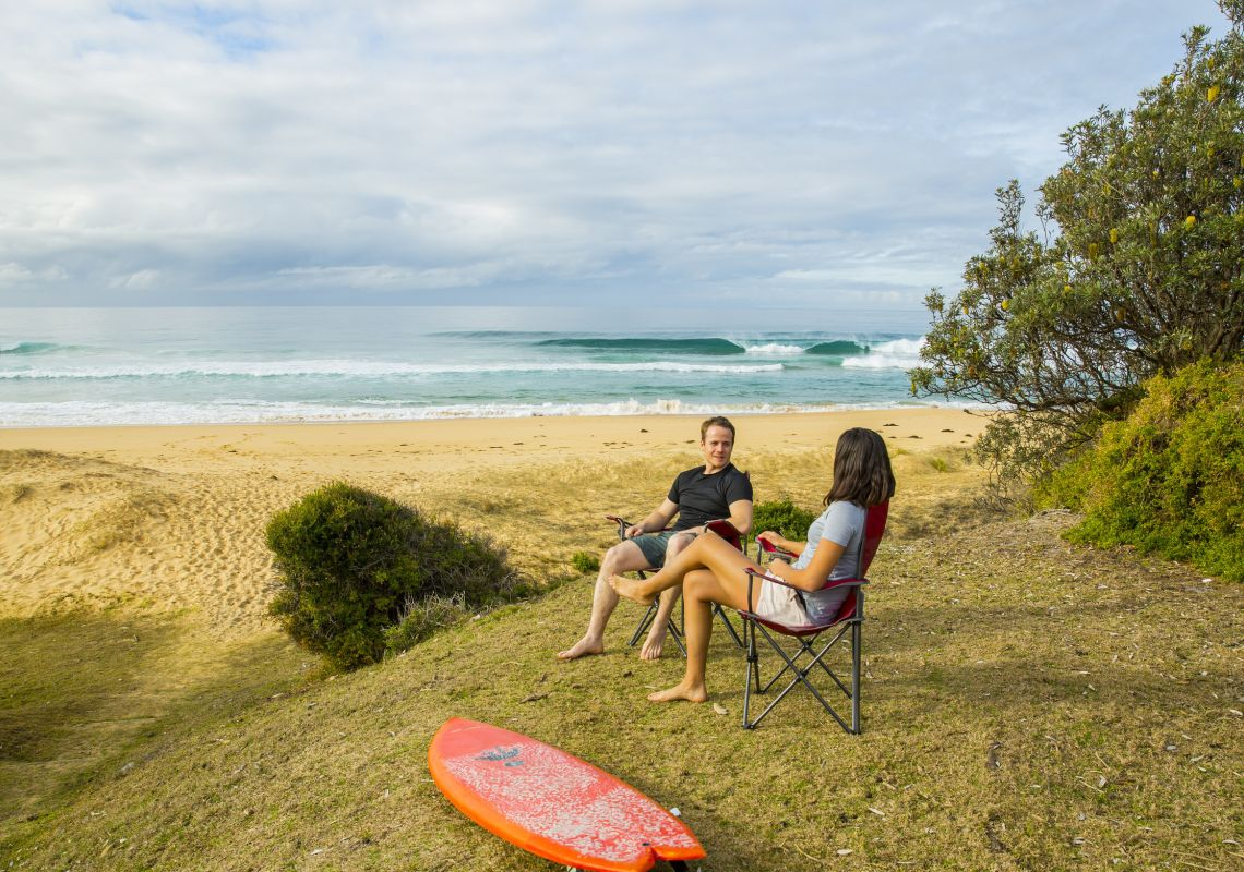 Couple relaxing at Gillards Campground inside Mimosa Rocks National Park, Tanja
