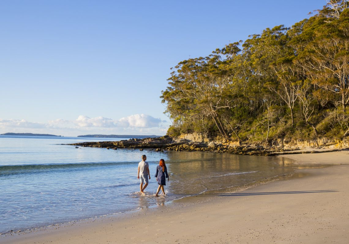 Couple enjoying a walk along Blenheim Beach, Jervis Bay