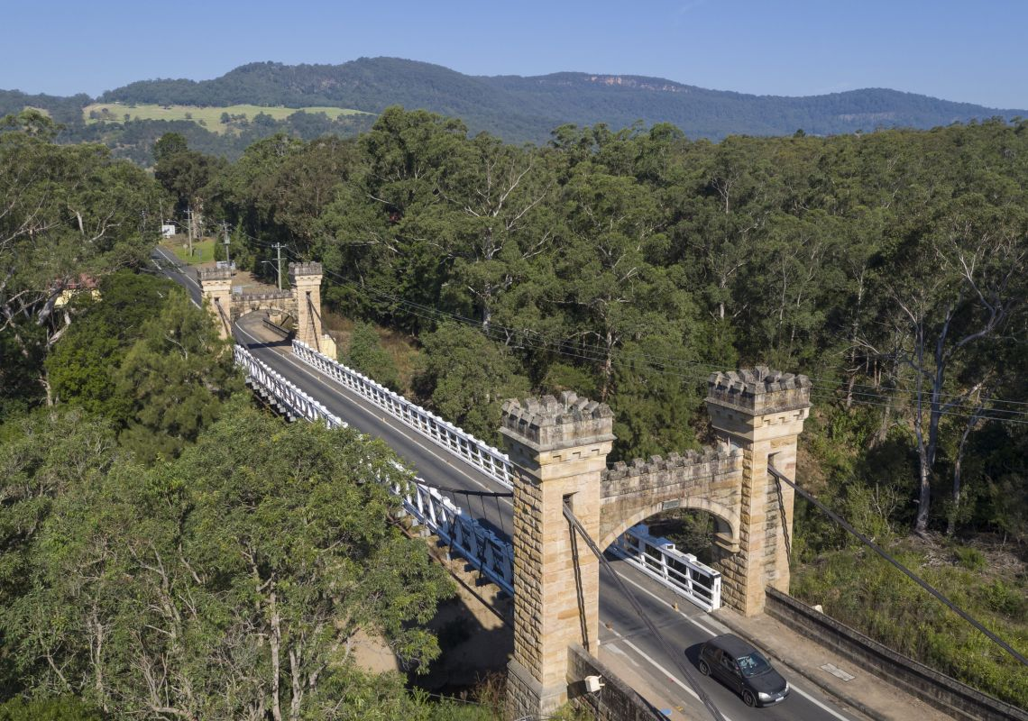 Car drives over the historic Hampden Bridge, Kangaroo Valley
