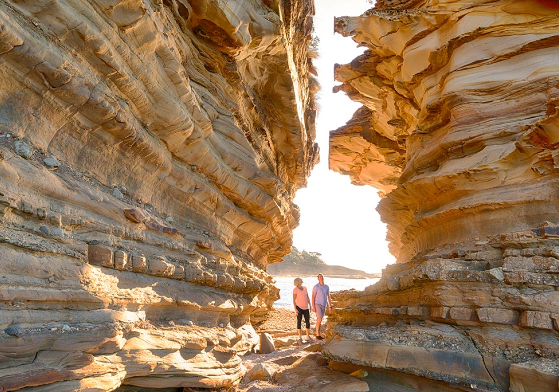 Couple enjoying a scenic morning walk around Wasps Head in Murramarang National Park, South coast