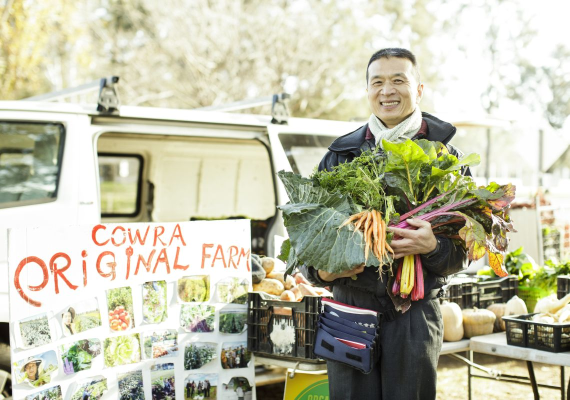 A local farmer holding his fresh produce at the Dubbo Farmers Market