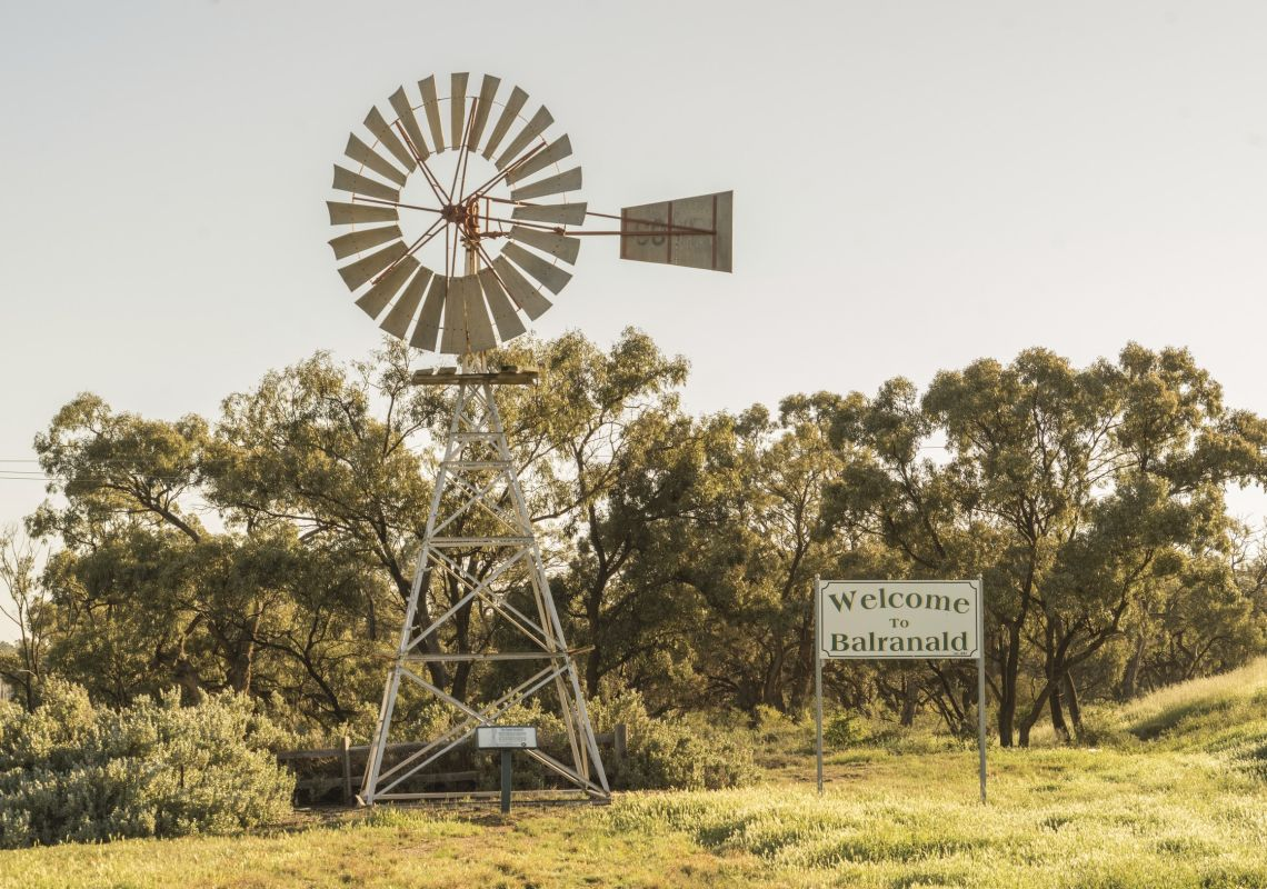 A Welcome to Balranald sign posted besides a local windmill at Balranald , Murray