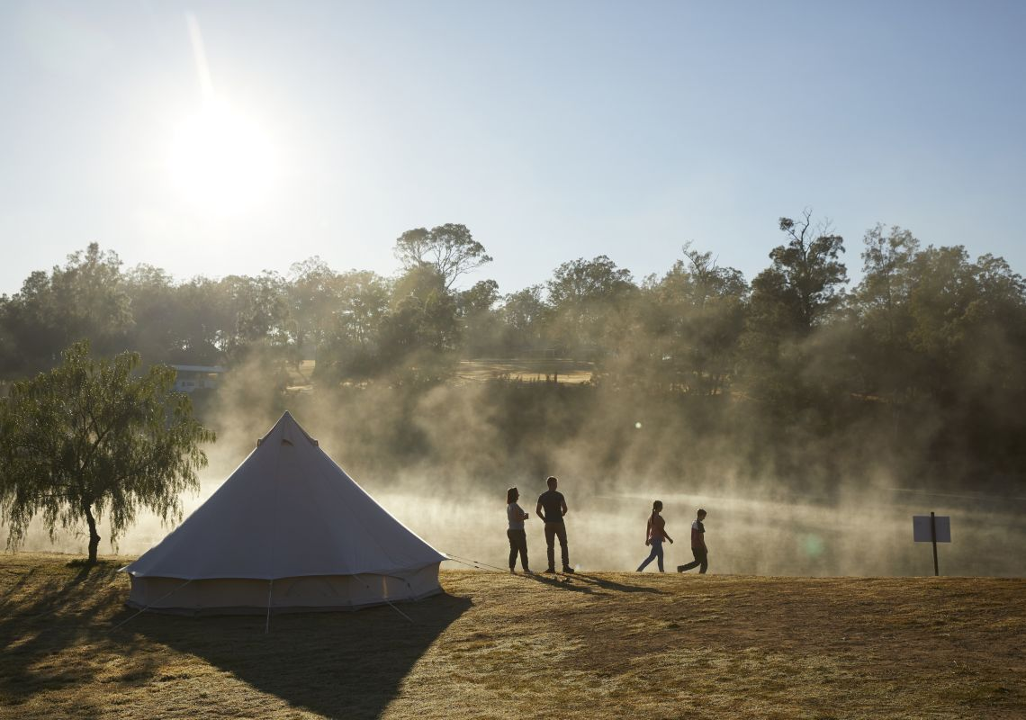 Family enjoying the morning sun and mist on the Hawkesbury River at Percy's Place Caravan Park in Pitt Town, Hawkesbury Valley