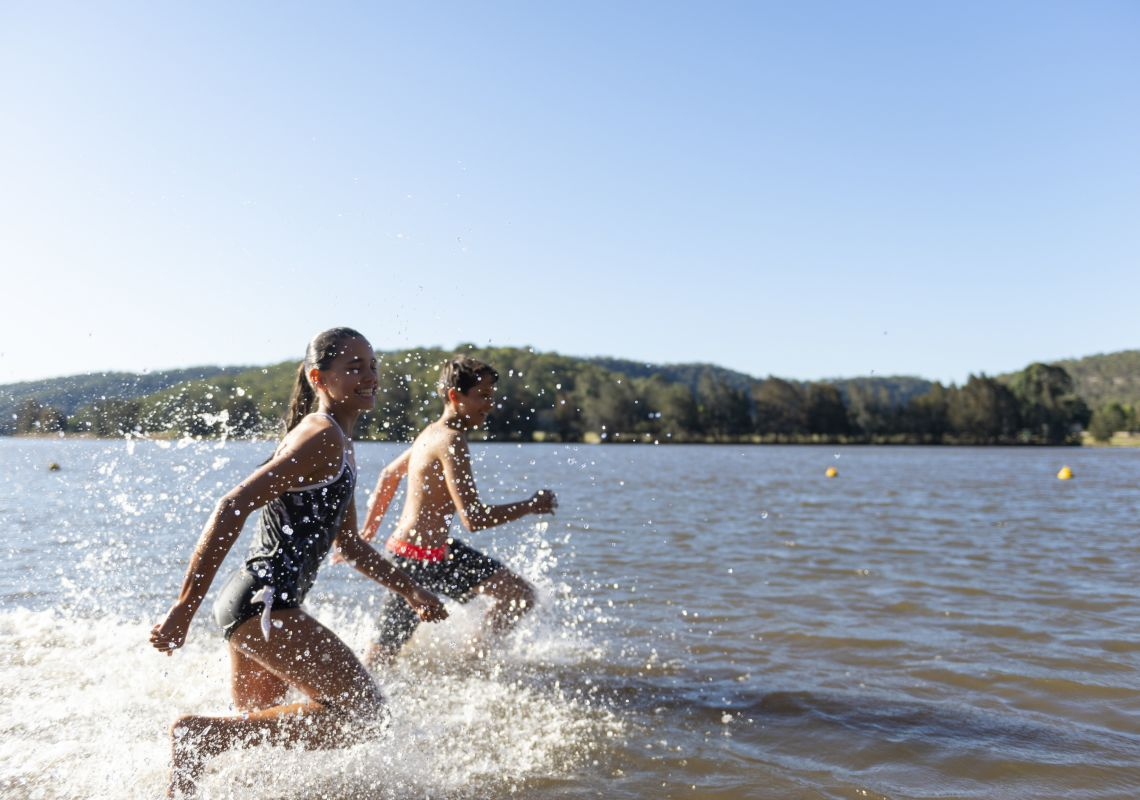 Children enjoying a day swimming in the Hawkesbury River by Leetsvale Caravan Park in Leets Vale, Hawkesbury Valley